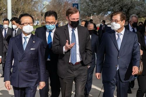 South Korean National Security Adviser Suh Hoon (R) converses with his US and Japanese counterparts -- Jake Sullivan (C) and Shigeru Kitamura (L) -- at the US Naval Academy in Annapolis, Maryland, on April 2, 2021, in this photo provided by the South Korean Embassy in Washington. (South Korean Embassy)