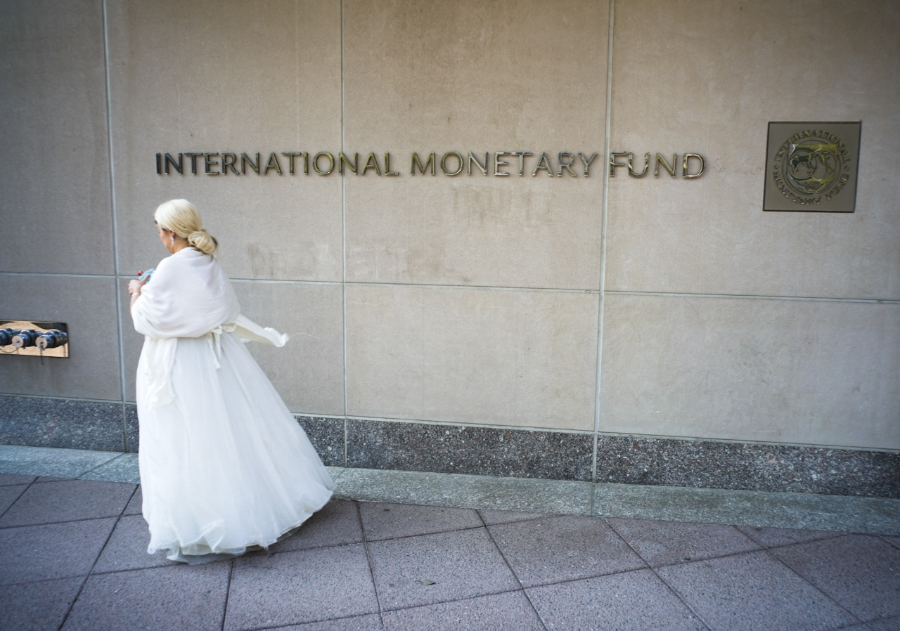 An activist dressed as Argentina's Evita Peron takes part in a rally calling for debt reform during the virtual Spring Meetings of the World Bank and International Monetary Fund, out side of IMF headquarters in Washington, DC on Thursday. (AFP-Yonhap)