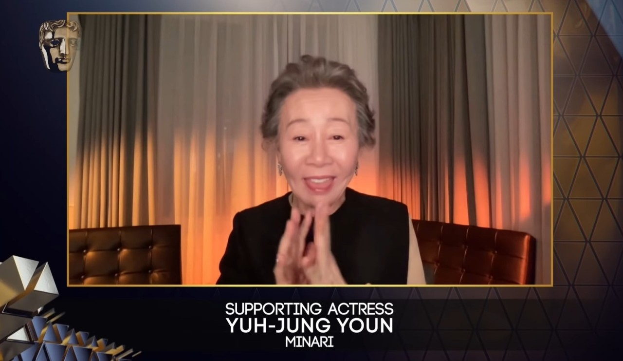 """Youn Yuh-jung gives an acceptance speech after winning best supporting actress at the British Academy of Film and Television Arts awards for her role in the American film """"Minari"""" on Monday. (YouTube)"""