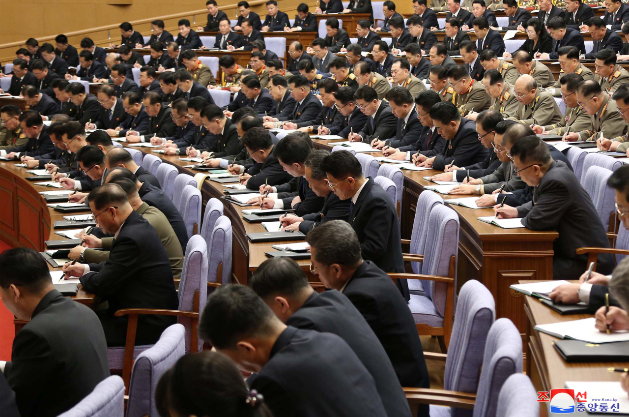 Participants take notes on North Korean leader Kim Jong-un's remarks during the second plenary meeting of the central committee of North Korea's Workers' Party in Pyongyang on Feb. 8, 2021, in this photo released by Korean Central News Agency. The meeting discussed details to put into practice a new five-year economic development plan set forth at the party's eighth congress the previous month. (Korean Central News Agency)