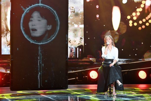 Musical actress Ock Joo-hyun sings with Supertone's AI system that can generate the voice of the late singer Kim Kwang-seok in