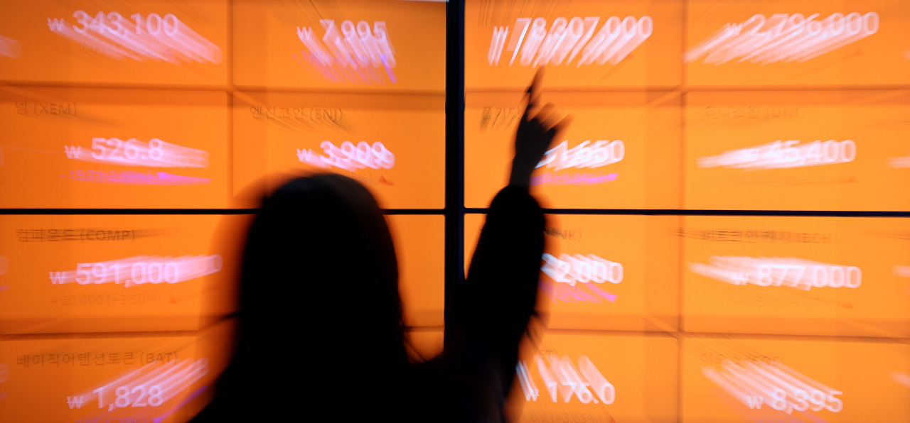A digital board at cryptocurrency exchange Bithumb shows the prices of various digital coins. (Yonhap)