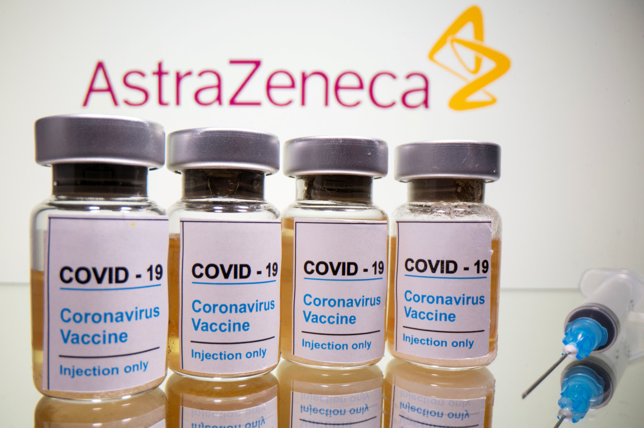 Vials with a medical syringe are seen in front of a displayed AstraZeneca logo in this illustration taken October 31, 2020. (Yonhap-Reuters)