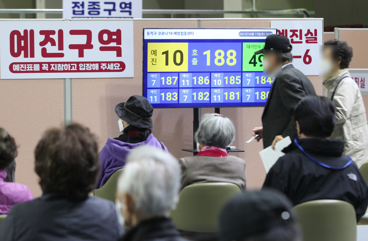 Seniors age 75 and over wait to be inoculated with Pfizer's COVID-19 vaccine at a vaccination center in southern Seoul on Saturday, in this photo provided by Dongjak Ward Office. (Dongjak Ward Office)