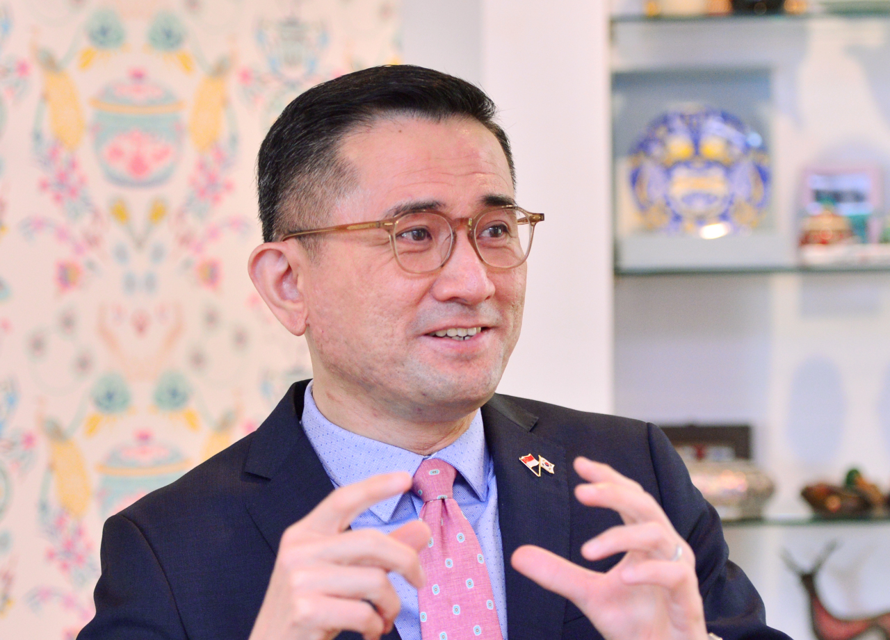 Singaporean Ambassador to Korea Eric Teo speaks during an interview with The Korea Herald on Thursday against a backdrop of a Peranakan patterned wall at the Singapore Residence in Seongbuk-dong, northern Seoul. (Park Hyun-koo / The Korea Herald)