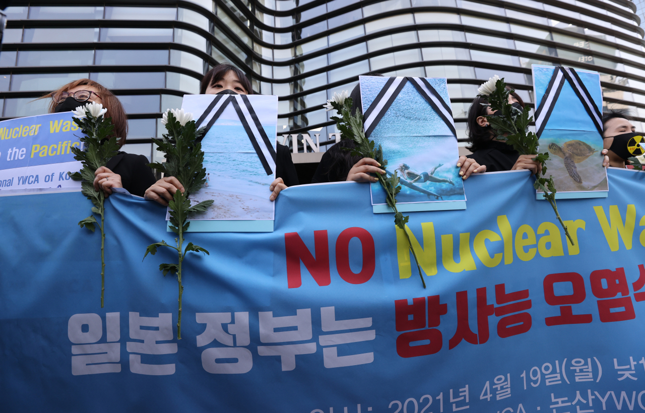Members of the National YWCA of Korea hold a news conference in front of the Japanese Embassy in Seoul on Monday, to demand Japan immediately scrap its decision to discharge radioactive water into the sea. (Yonhap)