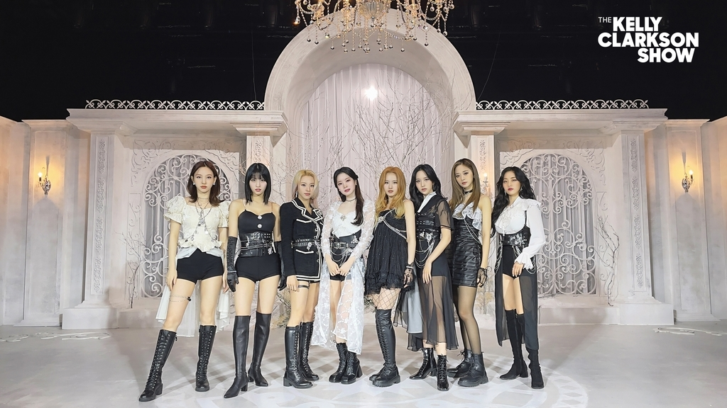 This photo, provided by JYP Entertainment on Tuesday, shows K-pop girl group TWICE posing for the popular American TV show