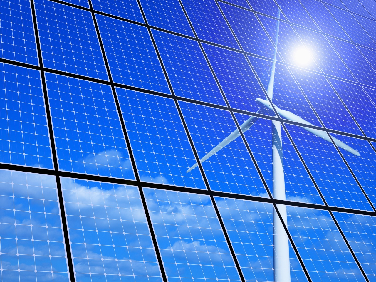 A visual concept image of a solar power panel that reflects a wind turbine on the surface (123rf)