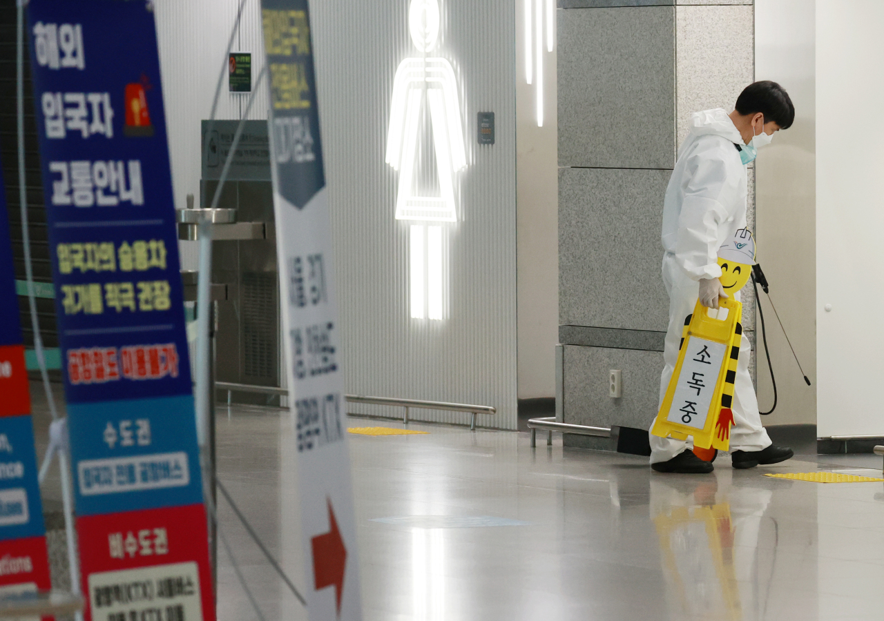 This photo taken on Tuesday, shows a health worker disinfecting a restroom inside Incheon International Airport in Incheon. (Yonhap)