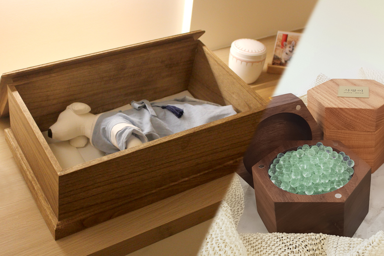 """A coffin and """"memory stones,"""" made from cremated pet remains (21gram)"""