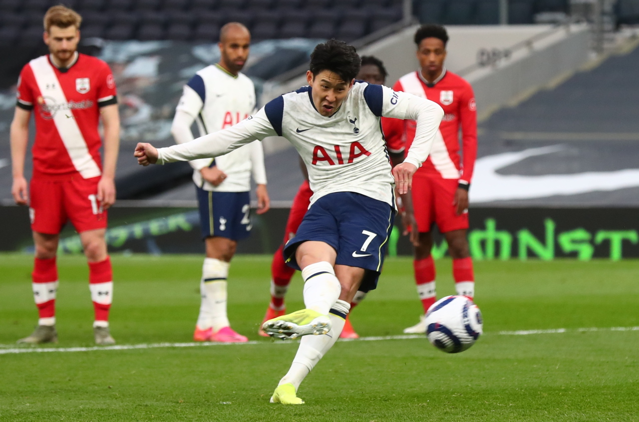 In this AFP photo, Tottenham Hotspur's South Korean striker Son Heung-min scores from the penalty spot during the English Premier League football match between Tottenham Hotspur and Southampton at Tottenham Hotspur Stadium in London on Wednesday. (AFP-Yonhap)
