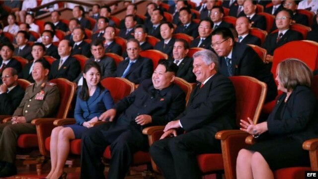 North Korean leader Kim Jong-un (3rd from R, front) and Miguel Diaz-Canel Bermudez (2nd from R), a member of the Political Bureau of the Central Committee of the Communist Party of Cuba and first vice president of the Council of State, watch an art performance by the Moranbong Band and the State Merited Chorus in Pyongyang on Sept. 7, 2015, in this photo provided by North Korea's Rodong Sinmun the next day. Bermudez led a Cuban delegation to North Korea to mark the 55th anniversary of the establishment of diplomatic relations between North Korea and Cuba. (Rodong Sinmun)