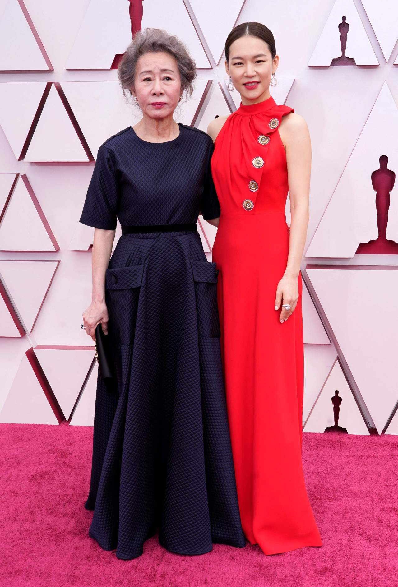 Youn Yuh-Jung (left) and Han Ye-ri arrive at the Oscars at Union Station in Los Angeles on Sunday. (AFP)