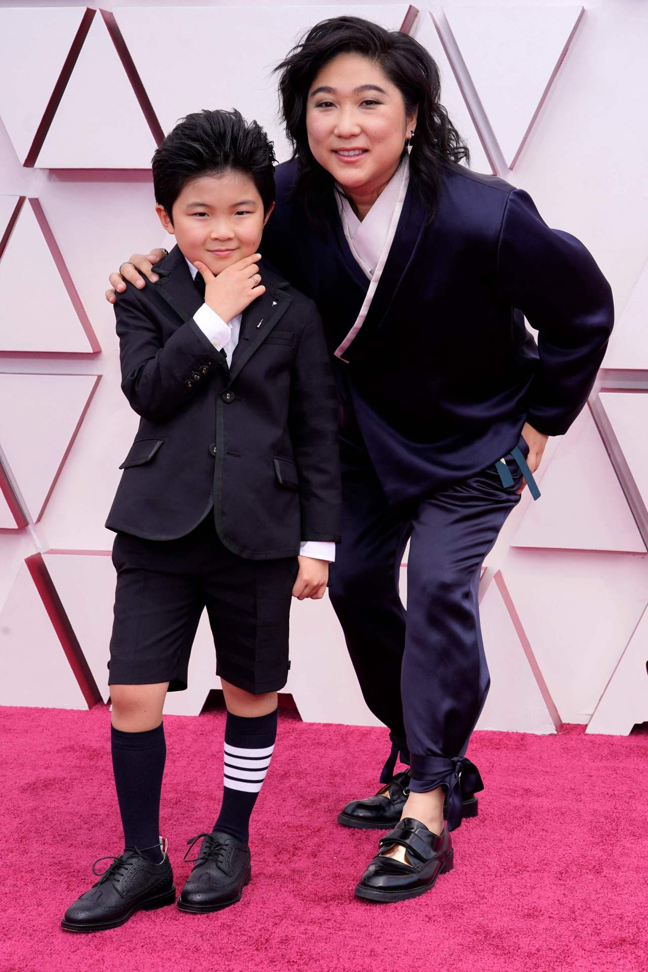 Actor Alan Kim (left) and producer Christina Oh arrive at the Oscars at Union Station in Los Angeles on Sunday.(AFP)