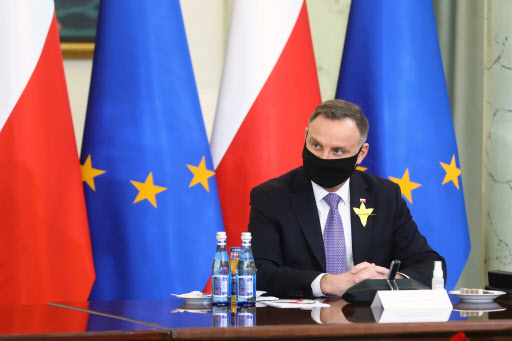 Polish president Andrzej Duda during a meeting with members of the Youth Climate Council at the Presidential Palace in Warsaw, Poland on April 19, 2021. (EPA-Yonhap)