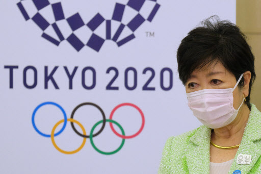 Tokyo Governor Yuriko Koike speaks to reporters after a five-party meeting via teleconference with the Tokyo 2020 Organising Committee, Government of Japan, International Olympic Committee and the International Paralympic Committee at the Tokyo Metropolitan Government building in Tokyo on Wednesday. (AFP-Yonhap)