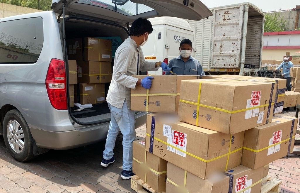 This photo, provided by the South Korean Embassy in India, shows workers moving 14 medical oxygen generators from South Korea that arrived in New Delhi on April 30, 2021, via a diplomatic pouch. (Yonhap)