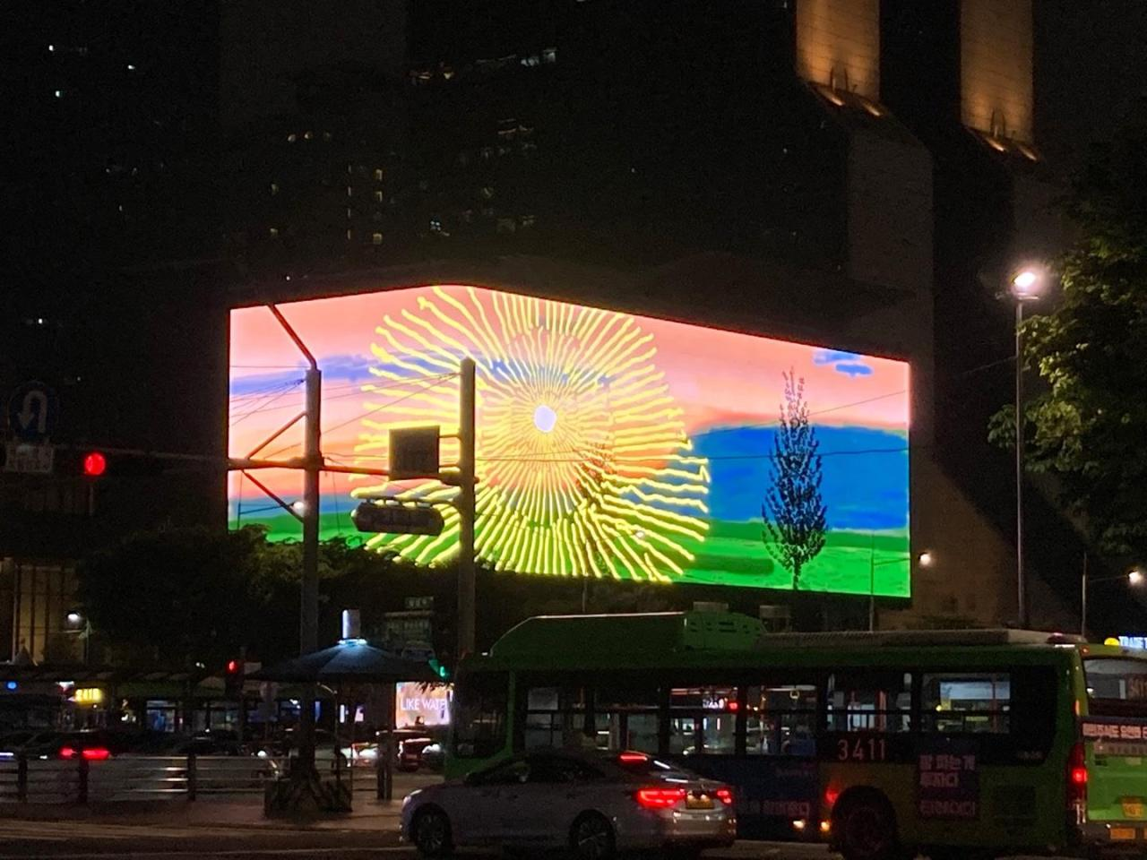 """David Hockney's """"Remember you cannot look at the sun or death for very long"""" video is shown on the LED screen at K-pop Square in Samseong-dong, Seoul, Saturday. (Yonhap)"""