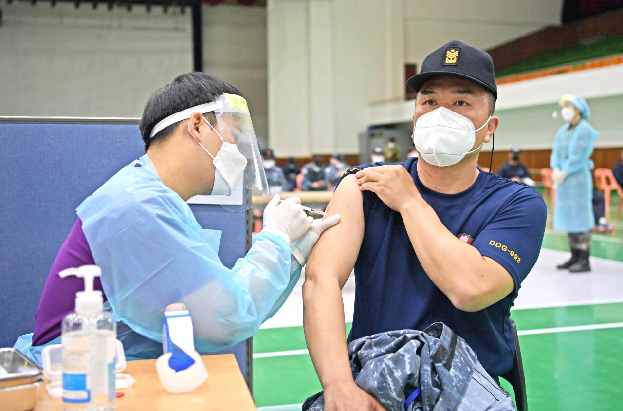 A Navy officer receives the first jab of AstraZeneca's COVID-19 vaccine at a vaccination center at a Naval base in Jinhae on the southeastern coast on April 28, 2021, in this photo provided by the South Korean defense ministry. (South Korean defense ministry)