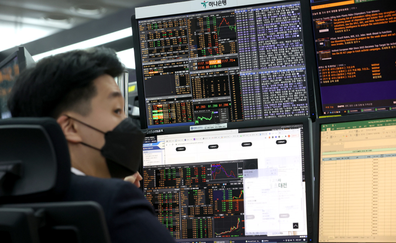 This photo, taken on Monday, shows stock trading screens in the trading room of Hana Bank in Seoul. (Yonhap)