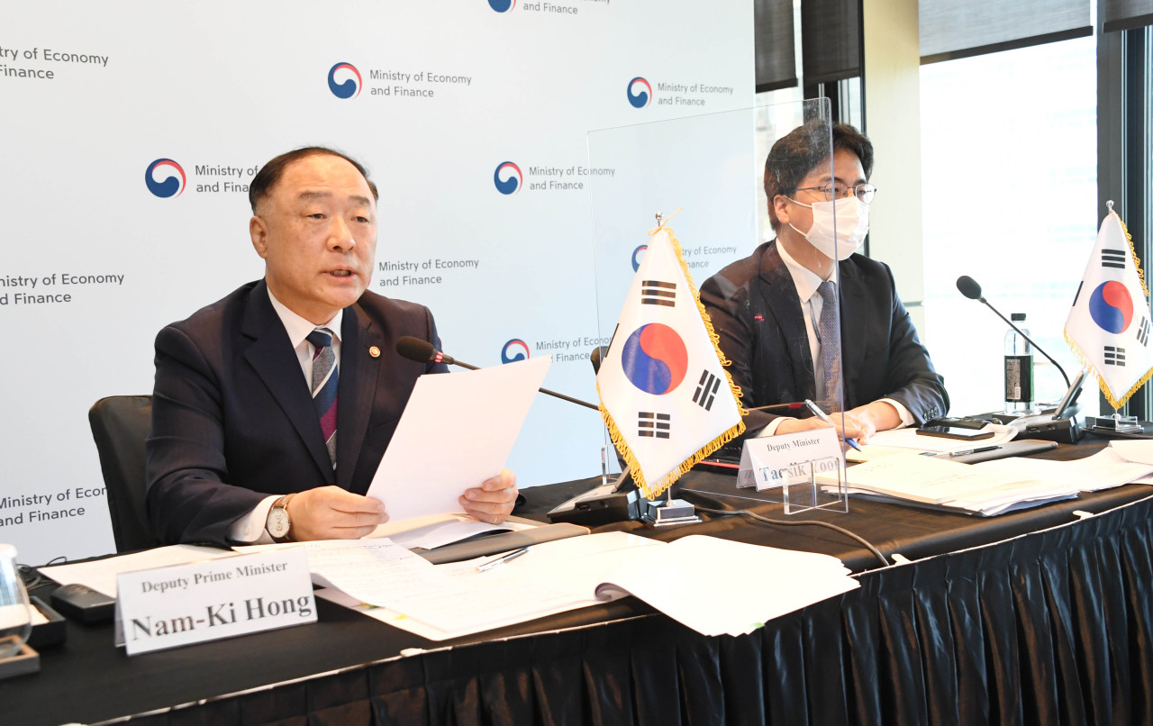 Finance Minister Hong Nam-ki (left) delivers the opening remarks at the ASEAN+3 Finance Ministers' and Central Bank Governors' Meeting, which was held online at the Four Seasons Hotel Seoul, in Seoul on Monday. (Yonhap)