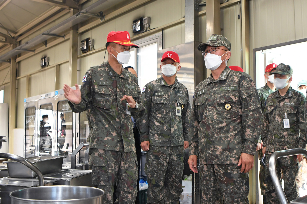 High-ranking officers of the South Korean Navy visit a restaurant for recruits to inspect the Navy's measures against the new coronavirus on Monday, in this photo provided by the Navy. (South Korean Navy)
