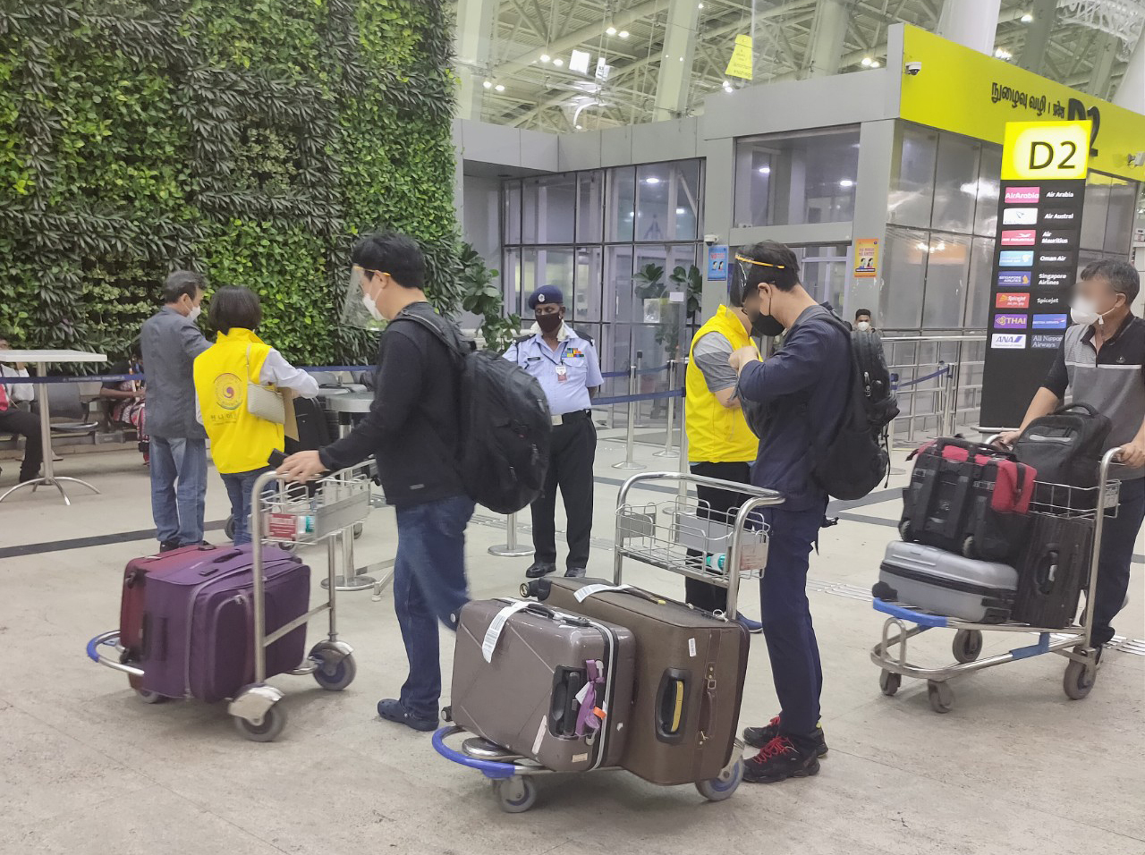 This photo provided by the Consulate General of South Korea in Chennai on Monday, shows South Korean citizens boarding a special flight to South Korea at Chennai International Airport in southern India. (Consulate General of South Korea in Chennai)