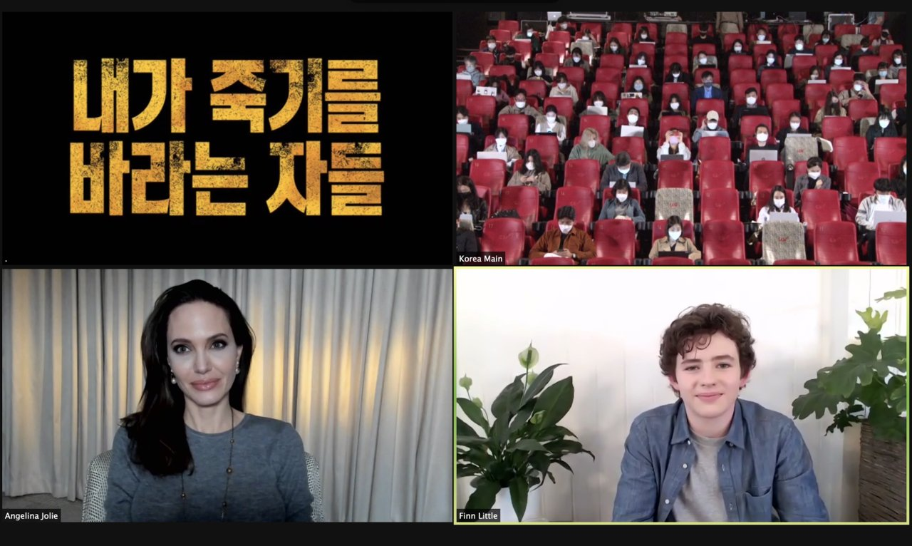 Angelina Jolie and Finn Little attend a video press conference held with local reports at CGV Yongsan in central Seoul on Tuesday. (Warner Bros.)