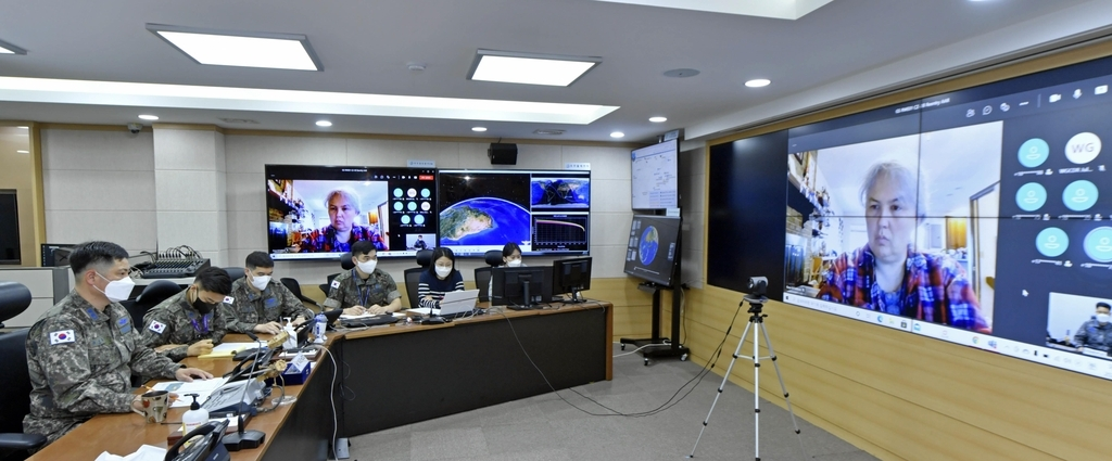 Members of the Korea Space Operations Center hold a videoconference with officials of the US-led Combined Space Operations Center on Friday, to discuss falling debris from a Chinese space rocket, in this photo provided by South Korea's Air Force. (South Korea's Air Force)
