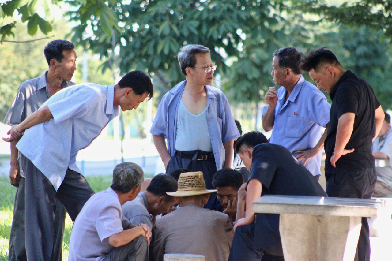A group plays a board game in Pyongyang in August 2019. (Lindsey Miller)