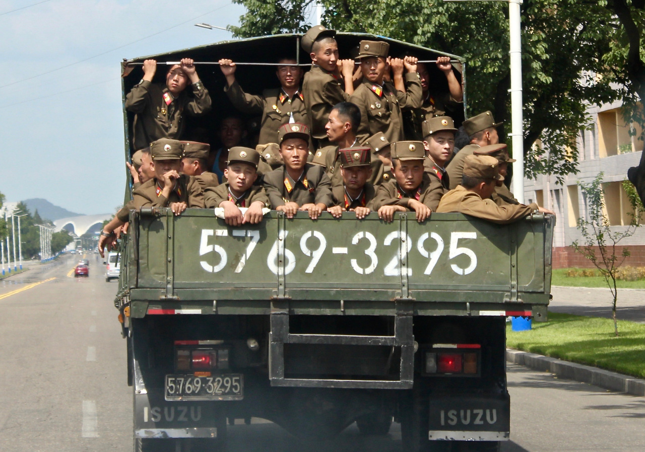 Soldiers are transported on back of a truck in Pyongyang in August 2018. (Lindsey Miller)