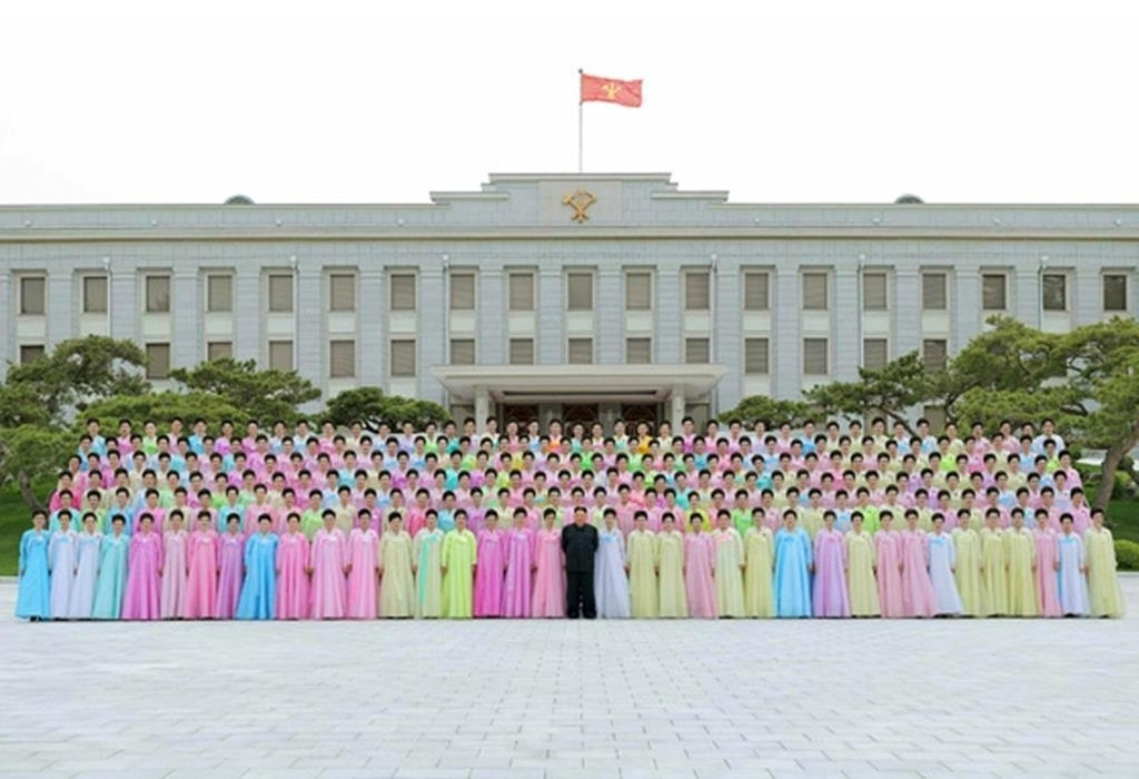 North Korean leader Kim Jong-un (C, 1st row) attends a group photo session with the art groups of servicemen's families from large combined units of the Korean People's Army (KPA) on Thursday, in this photo captured from the Rodong Sinmun the next day. (Rodong Sinmun)
