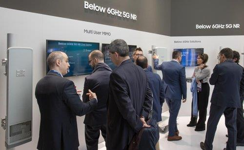 This photo provided by Samsung Electronics Co. shows visitors at the company's network business exhibition booth at the Mobile World Congress (MWC) 2019 in Barcelona, Spain, on Feb. 26, 2019. (Samsung Electronics Co.)