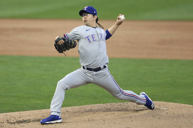 In this Associated Press photo, Yang Hyeon-jong of the Texas Rangers pitches in the bottom of the first inning of a Major League Baseball regular season game against the Minnesota Twins at Target Field in Minneapolis last Wednesday. (Yonhap)