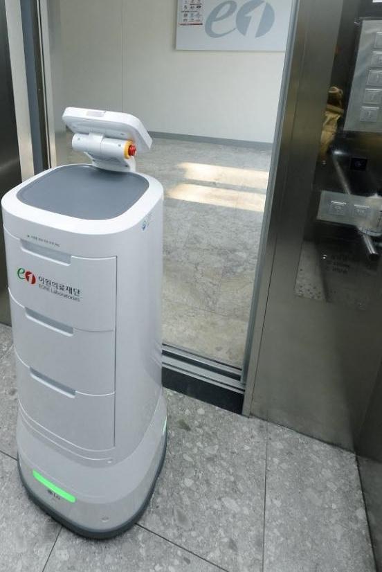 TK Elevator began trialing a robot-assisted elevator system with LG's self-driving service robot CLOi ServeBot last year. (TK Elevator)