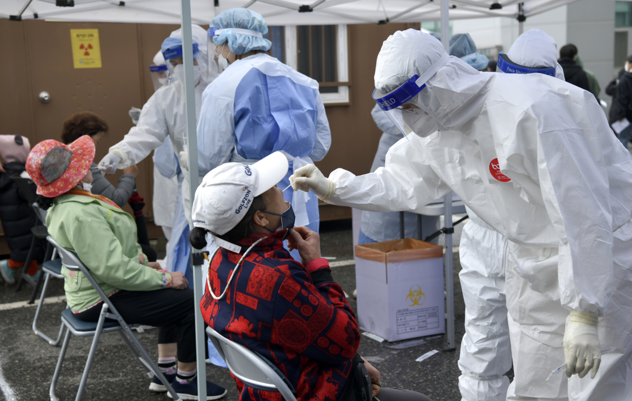 Medical workers collect specimens from people at a makeshift COVID-19 testing facility in Jangsu, North Jeolla Province, on Tuesday, in the photo provided by Jangsu County. (Jangsu County)