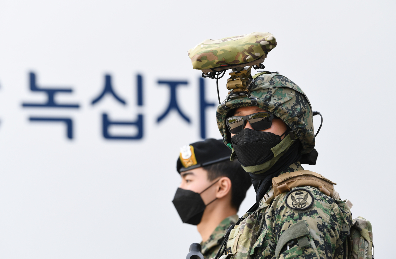 Service members take part in a COVID-19 vaccine transport drill in Ochang, North Chungcheong Province, on Wednesday, in this photo provided by the defense ministry. (Defense Ministry)