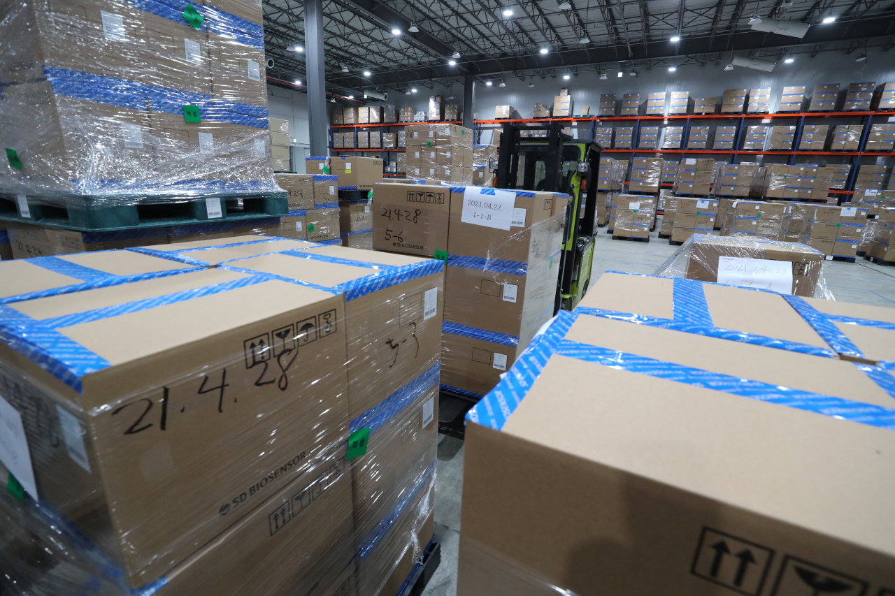 Boxes of self-testing kits are seen stacked up for nationwide distribution through a logistics center in North Chungcheong Province in April. (Yonhap)