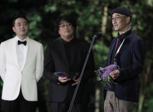 Director Lee Joon-ik (R) of