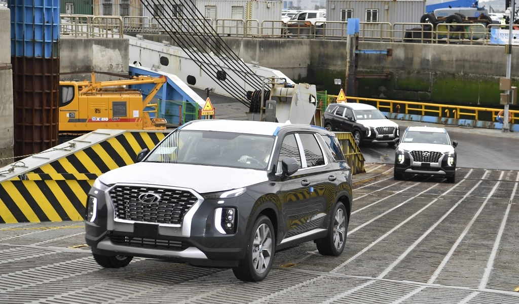 This photo taken on Saturday, and provided by Hyundai Motor shows Palisade SUVs that will be exported to the Democratic Republic of Congo at a port in Pyeongtaek, 70 kilometers south of Seoul. (Hyundai Motor)