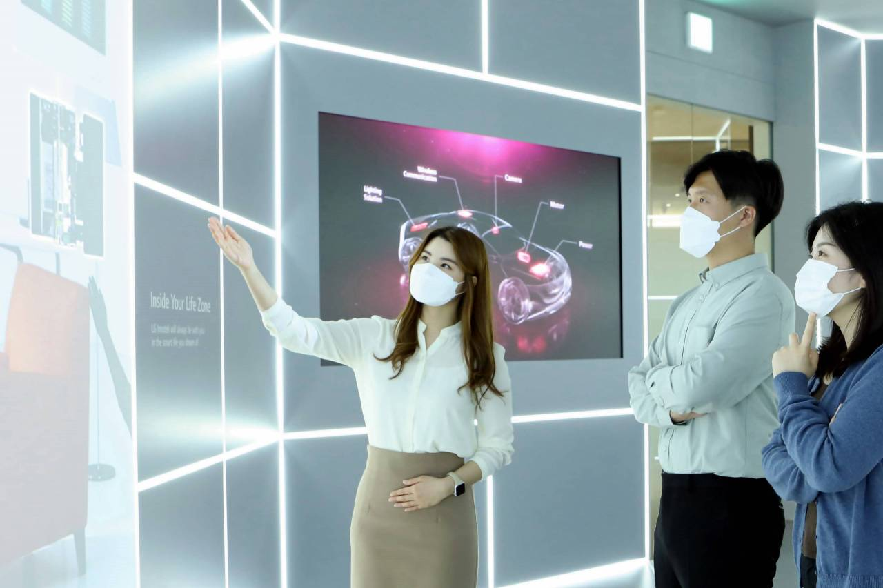 An LG Innotek worker explains the company's products to visitors at InnoTech Hall, an exhibition space within LG Science Park in Seoul. (LG Innotek)
