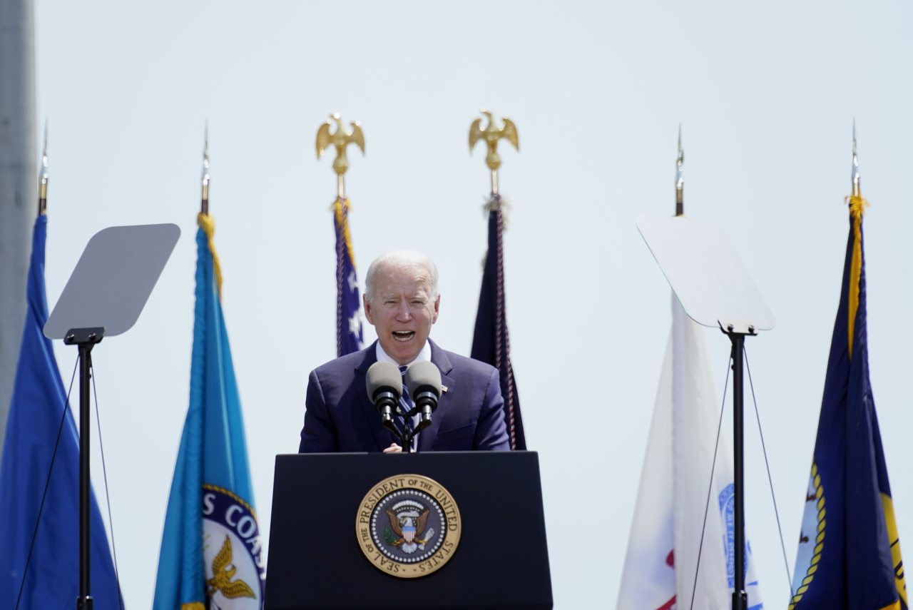 President Joe Biden speaks at the commencement for the United States Coast Guard Academy in New London, Conn., Wednesda. (AP-Yonhap)