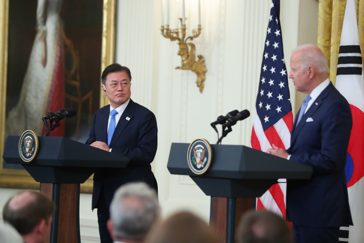 South Korean President Moon Jae-in (left) and US President Joe Biden hold a joint press conference at the White House in Washington on Friday. (Yonhap)