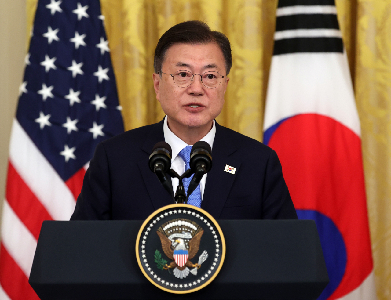 President Moon Jae-in speaks at a news conference after summit talks with US President Joe Biden at the White House on Friday. (Joint Press Corps)