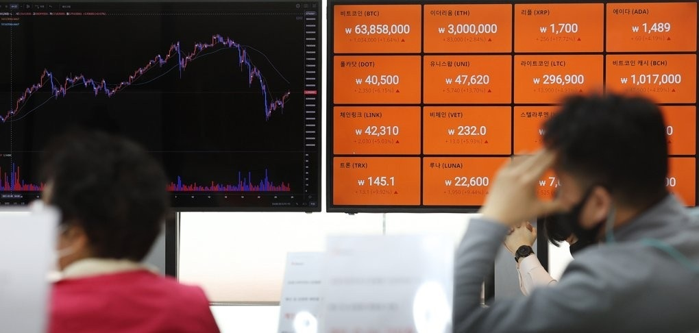 Digital signboards show the prices of cryptocurrencies at local cryptocurrency exchange Bithumb's office in southern Seoul on April 27, 2021. (Yonhap)
