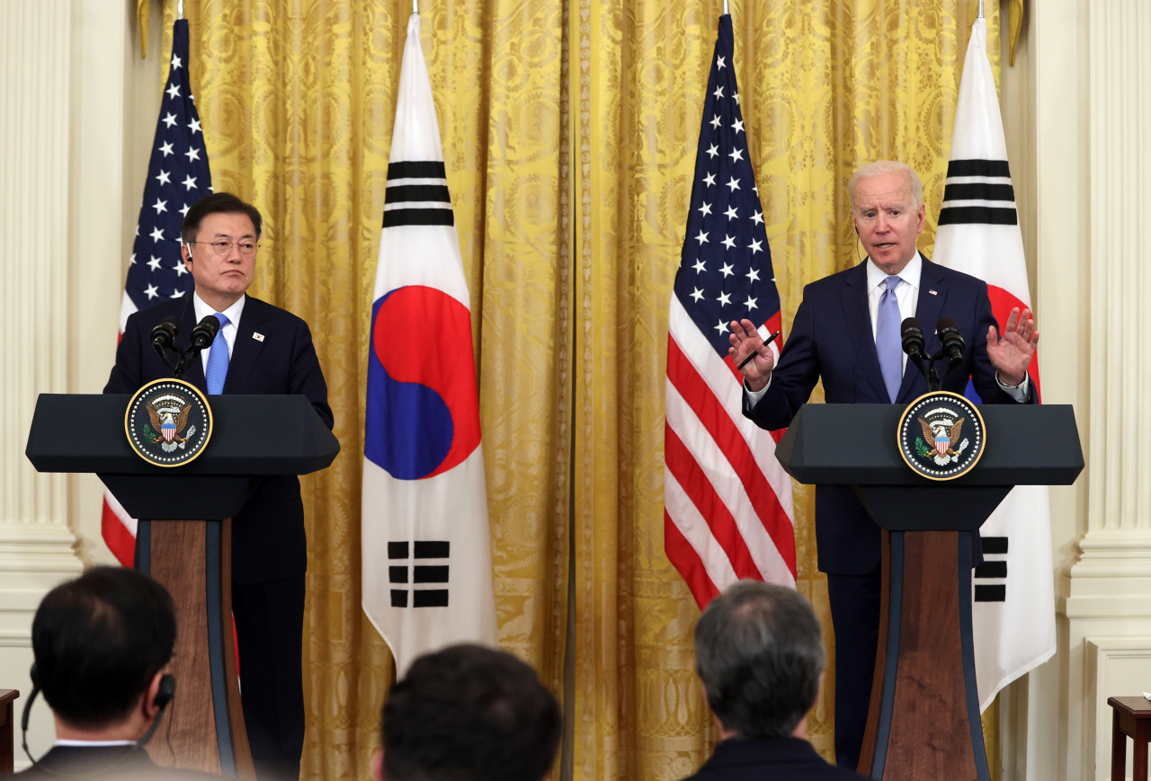 President Moon Jae-in (left) and US President Joe Biden hold a joint press conference at the White House in Washington, DC, Friday. (Yonhap)