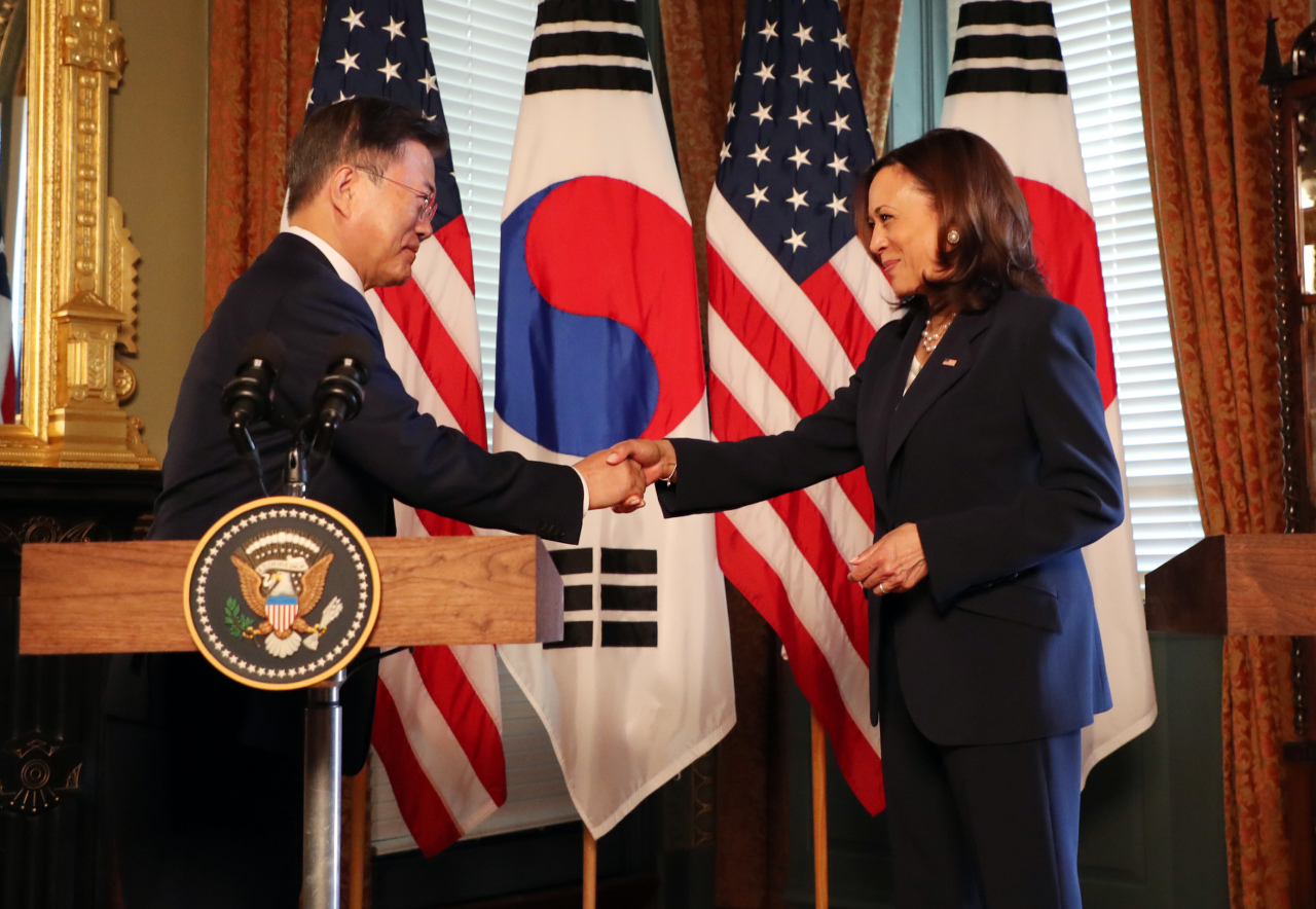 US Vice President Kamala Harris shakes hands with President Moon Jae-in at a press conference at the White House on Friday.