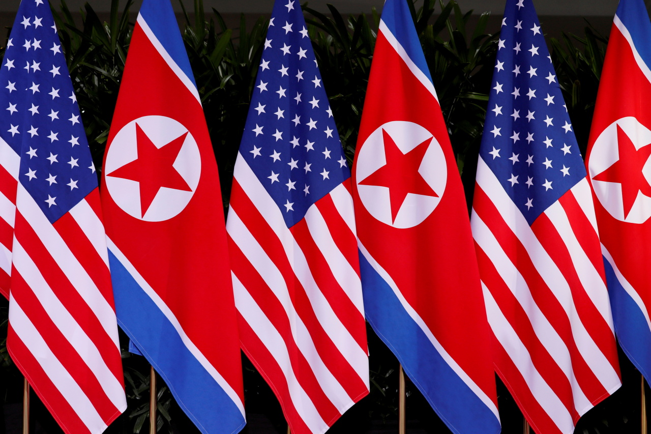 US and North Korean national flags are seen at the Capella Hotel on Sentosa island in Singapore June 12, 2018. (Reuters-Yonhap)