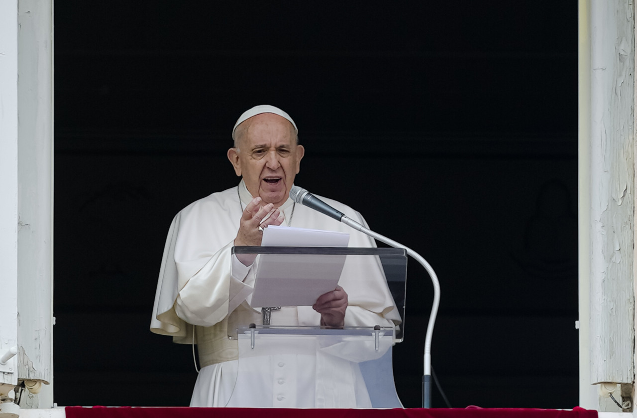 Pope Francis speaks from the window of his studio overlooking St. Peter's Square at The Vatican to a crowd of faithful and pilgrims gathered for the Sunday Angelus noon prayer, Sunday. (AP-Yonhap)