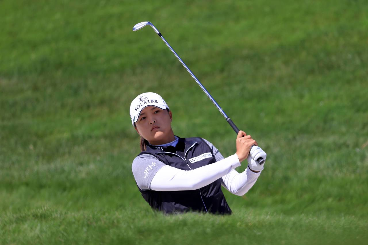In this Getty Images photo, Ko Jin-young of South Korea watches her approach shot on the third hole during the final round of the US Women's Open at the Olympic Club in San Francisco on Sunday. (AFP-Yonhap)